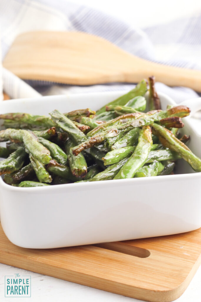 White bowl with air fried green beans