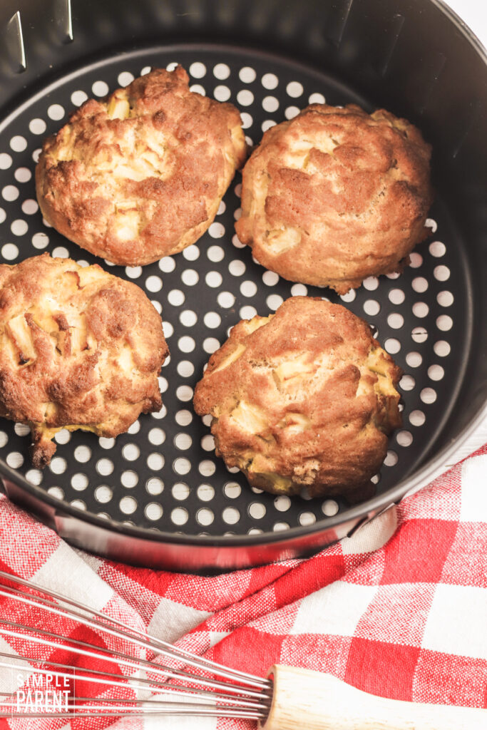 Cooked apple fritters in air fryer basket