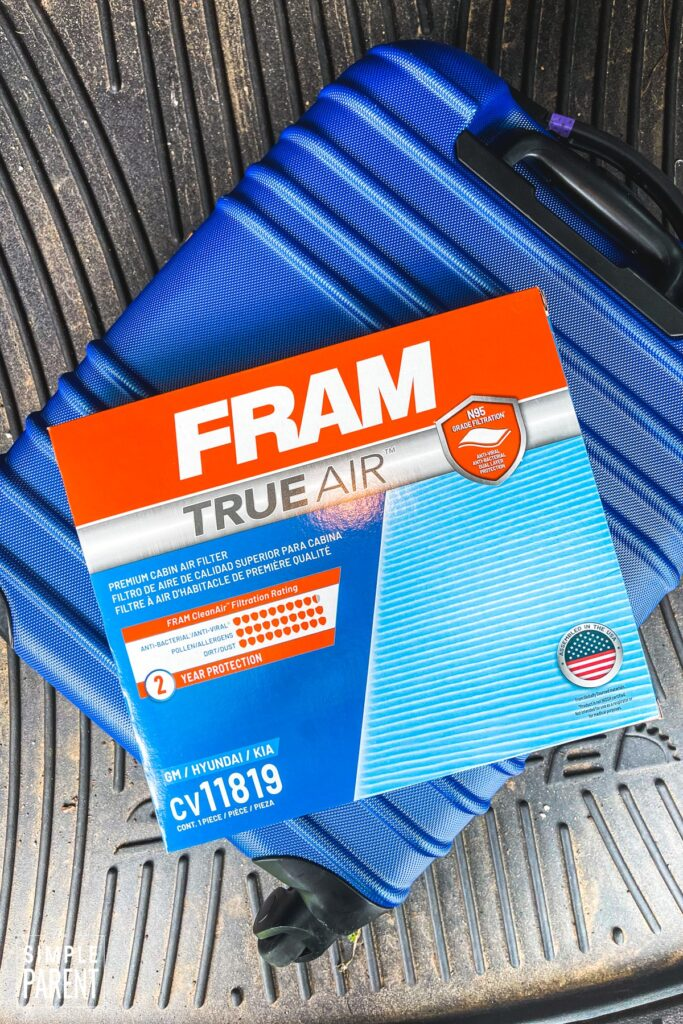 Blue suitcase with FRAM True Air cabin filter