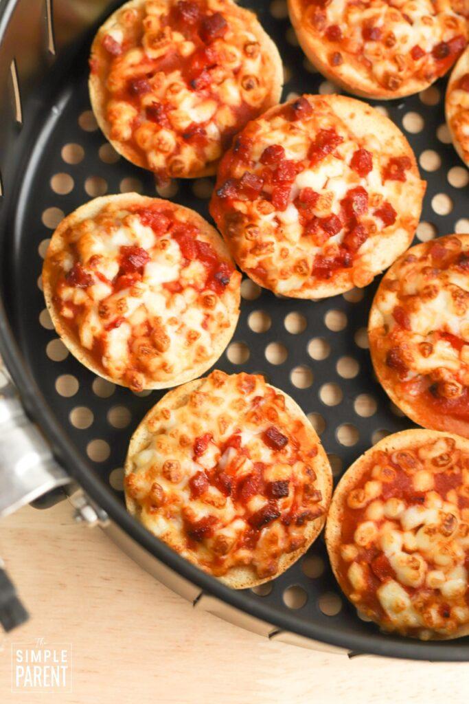 Mini pizza bagels in air fryer basket