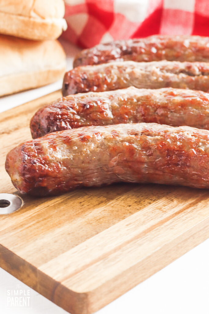 Air fried beer brats on cutting board