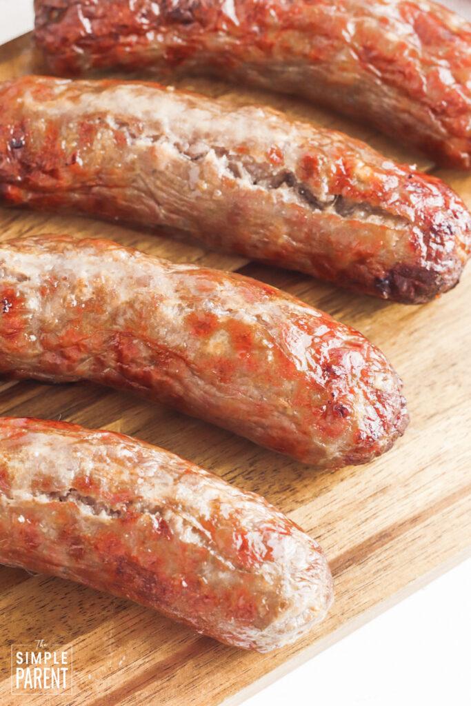 Air fryer bratwurst on cutting board