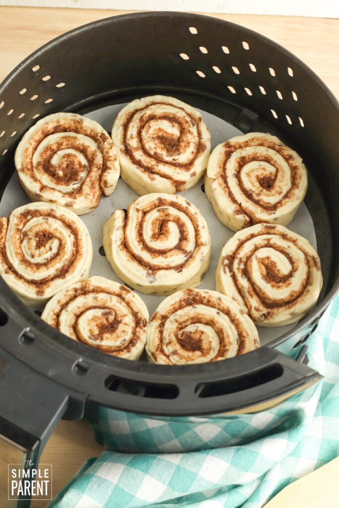 Refrigerated cinnamon rolls in air fryer basket