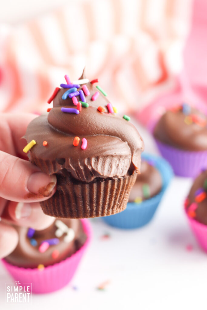 Hand holding air fryer chocolate cupcake