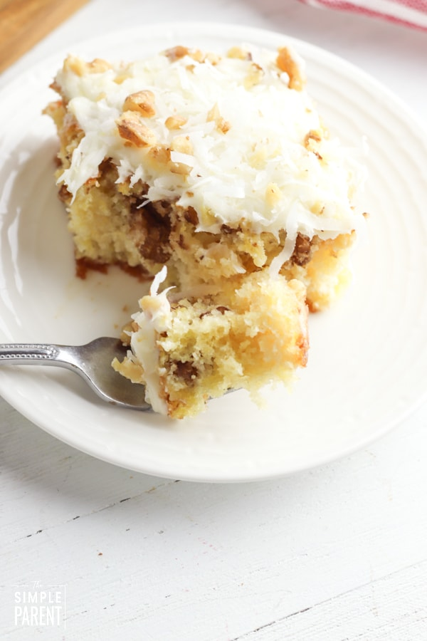 Bite of crushed pineapple cake on fork
