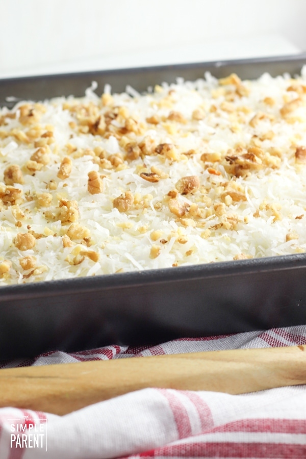 Crushed Pineapple Cake with coconut and walnuts in pan