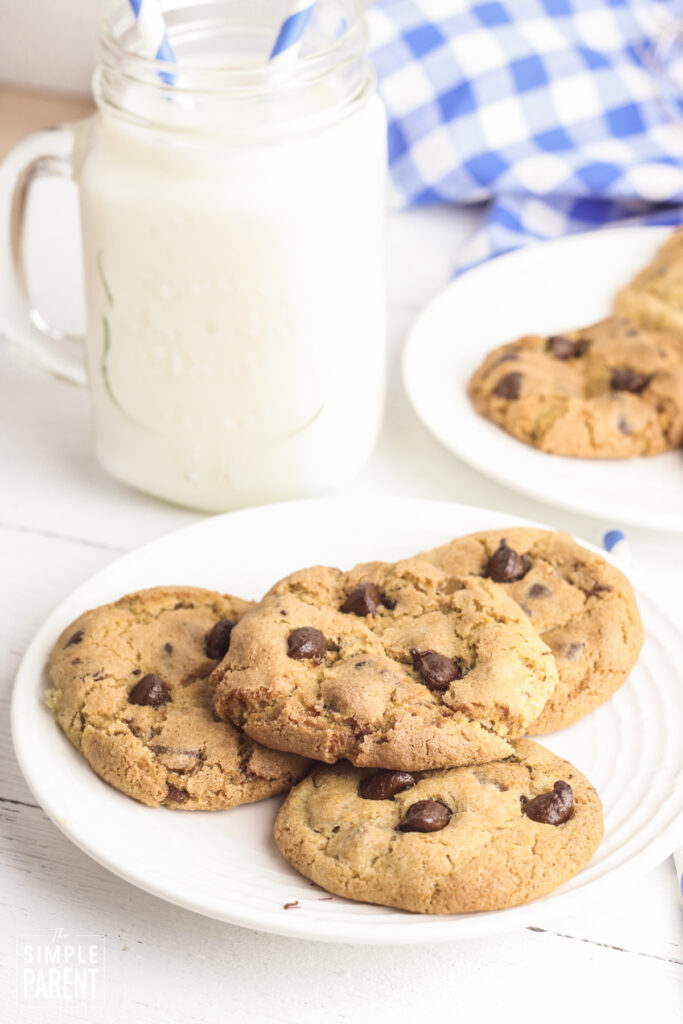 Chocolate Chip cookies air fried and placed on white plate with glass of milk