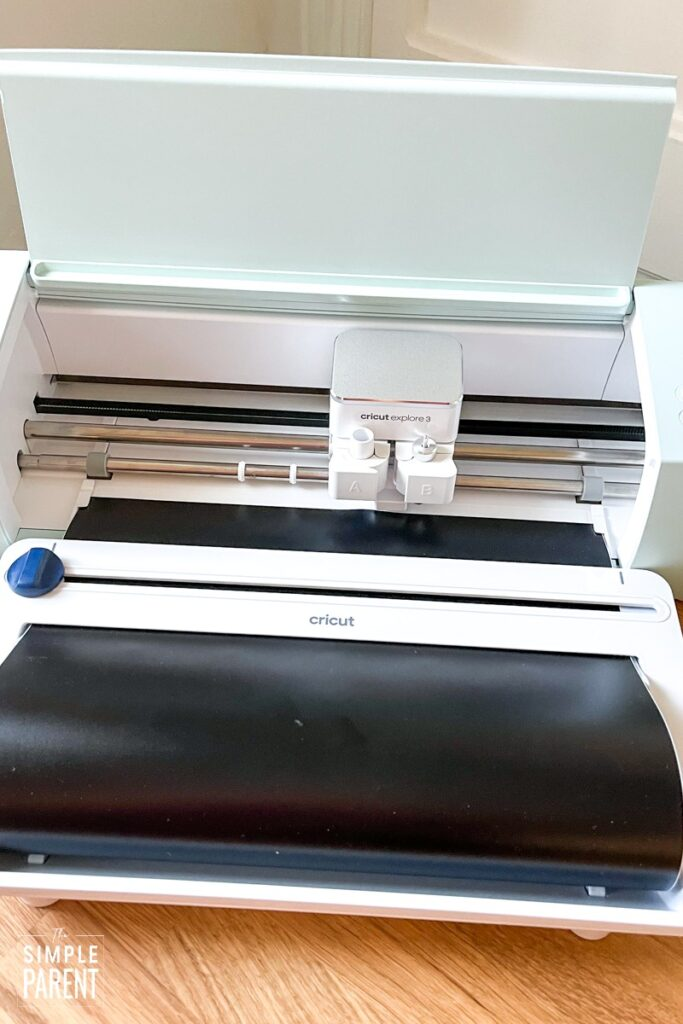 Cricut Explore 2 Machine with black vinyl loaded
