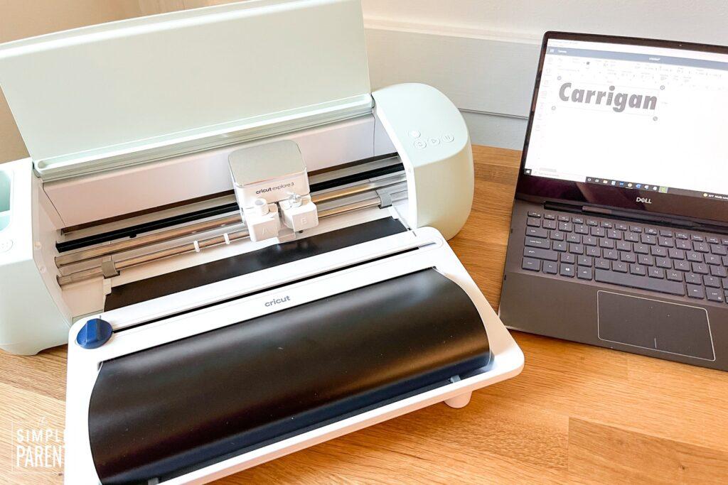 Laptop using Cricut Design Space and Cricut Explore 3 on counter