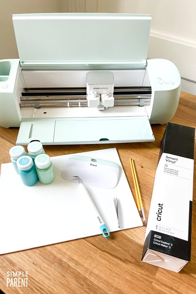 Cricut Explore 3 machine with craft supplies for silhouette painting