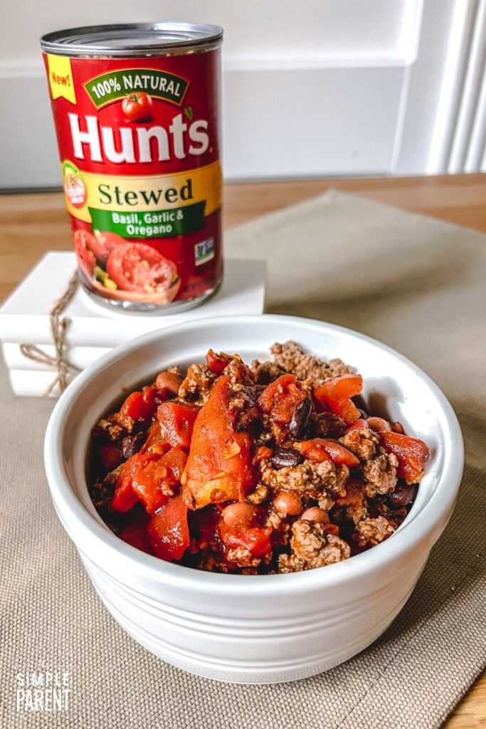 Bowl of chili and can of stewed tomatoes