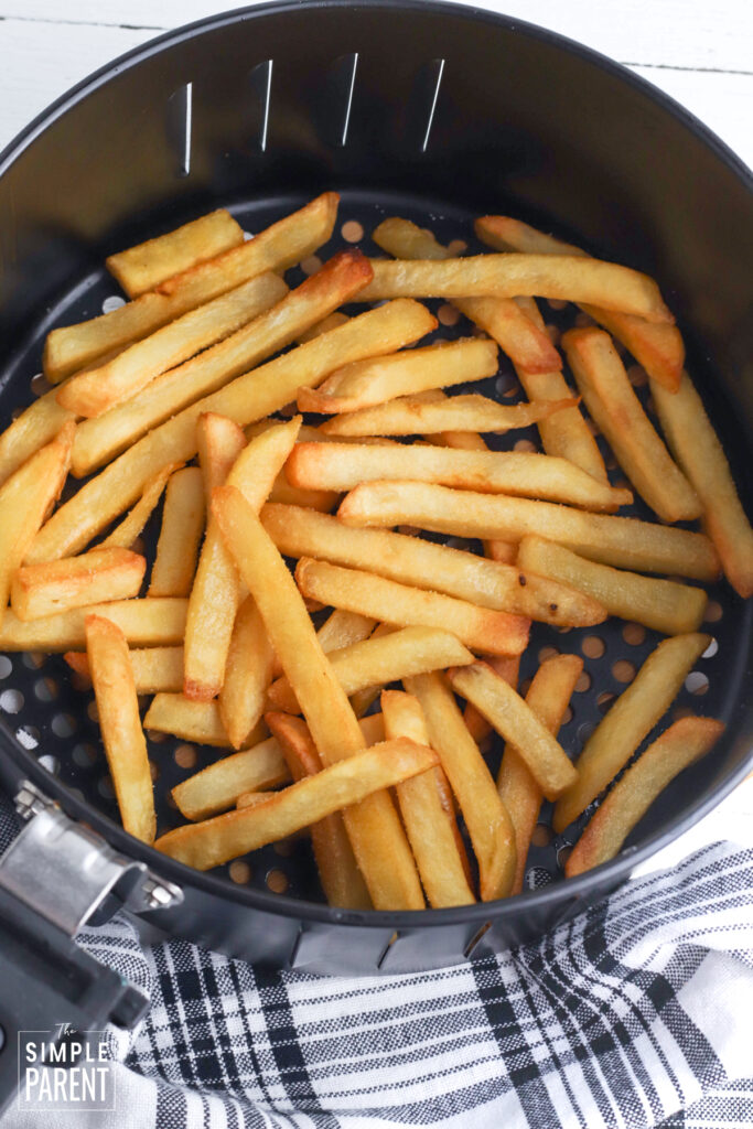 Cooked frozen french fries in air fryer basket