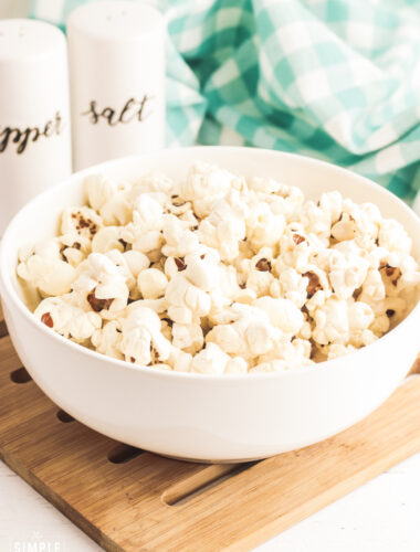Air Fryer Popcorn in white bowl on cutting board