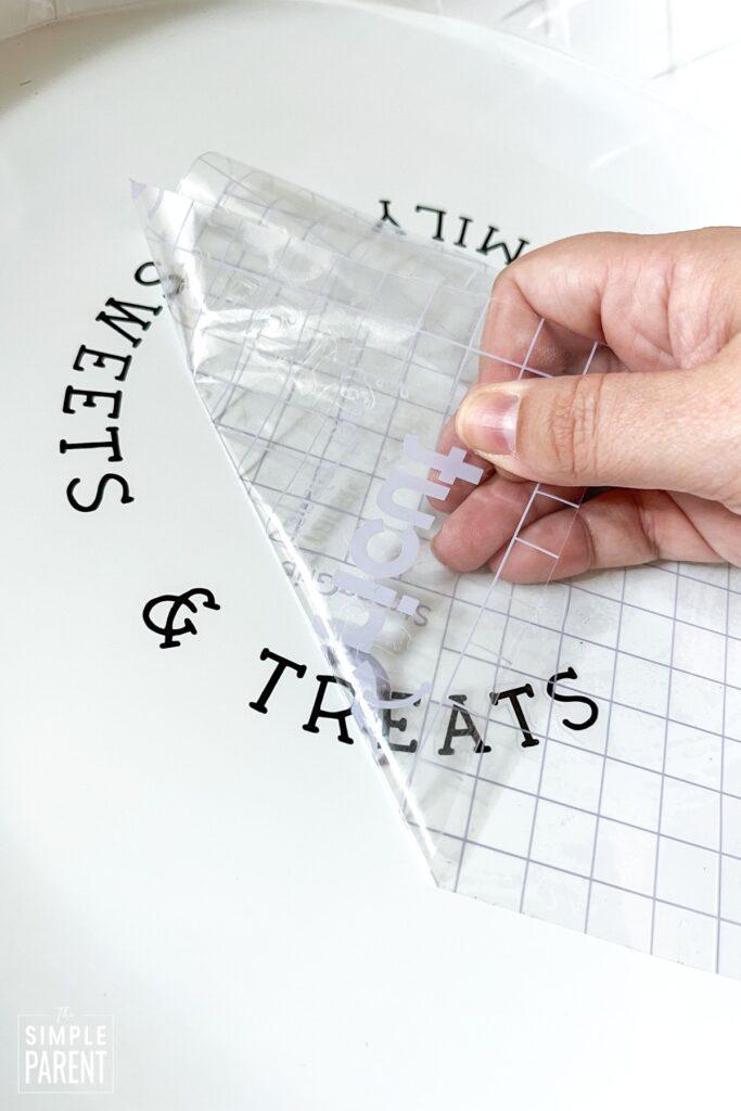 Peeling Cricut Transfer Tape off vinyl lettering